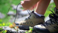 Woman attaching her shoes Stock Footage