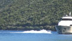 Sky jet on the sea near a luxury boat anchored,  Mediterranean bay, Water sport. - stock footage