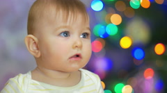 The baby look and smile. Close-up portrait view - stock footage