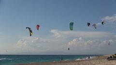Young tourist training for kitesurfing contest. Mediterranean island. Stock Footage
