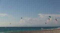 Kite surfing. Mediterranean island beach, colorful kites, hot summer day. - stock footage