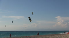 Kitesurfing show on a watersports dedicated beach in Ionian islands. - stock footage