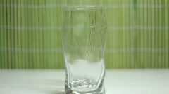 Pouring water into glass Stock Footage
