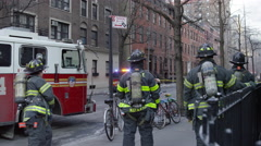 Firefighters standing still watching fire firetruck slow motion 4K Manhattan NYC Stock Footage