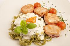 Round chicken with pancetta and tagliatelle Stock Photos