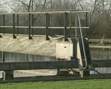 Moving bridge in Primary treatment basin of Sewage treatment plant Stock Footage