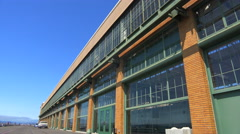 Wide shot of a large warehouse or factory. Stock Footage