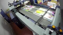 4k folding machine HD CRANE SHOOT folds printed offset sheet as part of newsp Stock Footage