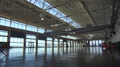 Interior of an empty warehouse, factory or showroom. Stock Footage