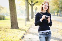 Happy Amateur Photographer in a Park - stock photo