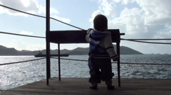 Curious baby near charcoal grill - Stock Footage