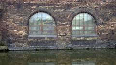 Factory arched old windows canalside Middleport Stock Footage