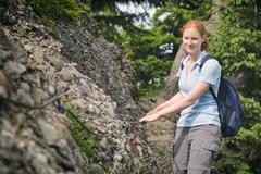 Hiker on a Narrow Alpine Trail - stock photo