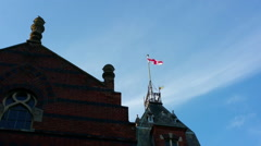 30s English Flag Flies Over Building in Lightly Cloudy Silent - stock footage