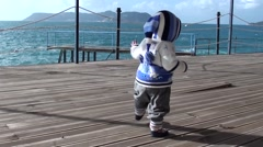 First awkward gaits near the sea- - stock footage