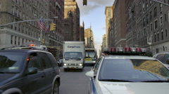 Police car firetruck city bus driving traffic 5th Empire State Building NYC Stock Footage
