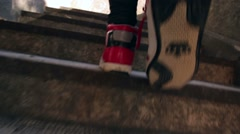 Girl with red shoes walking up the stairs Stock Footage