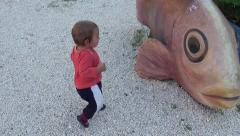 Baby does his first wobbly steps Stock Footage