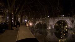 Bridge Ponte Sisto &  waterfront Lungotevere Raffaello Sanzio at night. Rome Stock Footage