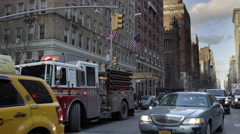 Firetruck ambulance East Village bus cars traffic 5th Empire State Manhattan NYC Stock Footage
