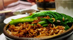 4k UHD time lapse video on eating Claypot chicken rice with leafy vegetable Stock Footage