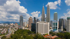 Timelapse of Kuala Lumpur skyline with Petronas Twin Towers - Eye level view Stock Footage