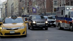 Emergency vehicle parked NYU dormitory traffic 5th ave in Manhattan, NYC Stock Footage
