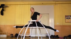 Young girl gymnast trains stretching for twine in pop-circus studio Stock Footage