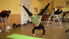 Young people hard training in pop-circus acrobatic troupe - stock footage