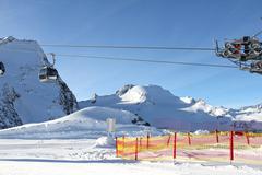 Ski lift in mountains - stock photo