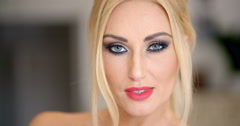 Pretty Face with Makeup of a Blond Woman Stock Footage