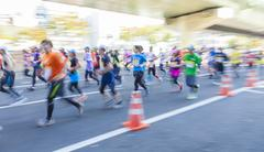 Runners participating in the 2014 Osaka Marathon - stock photo