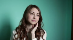 Beautiful girl looking thoughtfully into the distance Stock Footage