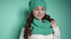 Beautiful girl in a turquoise knitted hat Stock Footage