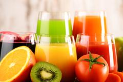 Glasses of fresh organic vegetable and fruit juices. Detox diet. Stock Photos