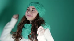 Girl in a turquoise knitted hat dancing Stock Footage
