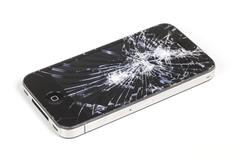 iPhone 4 with seriously broken retina display screen - stock photo