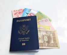 Stock Photo of american passport and international currencies