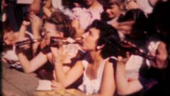 1751 - men & women in beer drinking contest at picnic - vintage film home movie Stock Footage