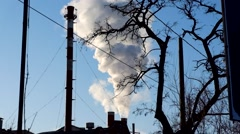 Pollution, smoke and steam discharged from an industrial facility Stock Footage