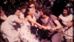 1750 - tug of war, women vs women at the picnic - vintage film home movie Stock Footage