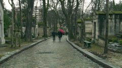 Paris - People Walking in the Rain at Pere Lachaise Cemetery Stock Footage