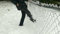 Super slow motion kicking chain link fence covered by freezing rain / ice Stock Footage