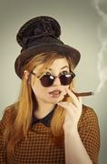 Tramp girl wears old top hat in vintage photo style - stock photo