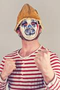 Weird scary masked mime in striped red and white shirt - stock photo