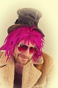 Pink haired bearded bum lunatic man with cool sunglasses - stock photo