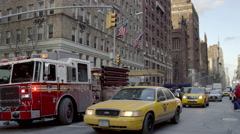 Taxis cars traffic parked fire truck Empire State Building 4K Manhattan NYC Stock Footage
