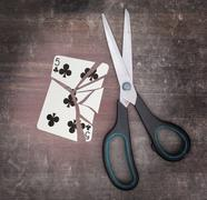 Concept of addiction, card with scissors - stock photo