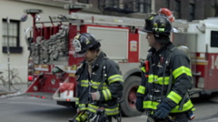 2 FDNY firefighters cross street firetruck NYPD police slow motion 4K NYC - stock footage