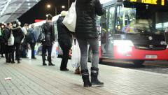 Bus station people wait and get on the bus  - road with cars - night city Stock Footage